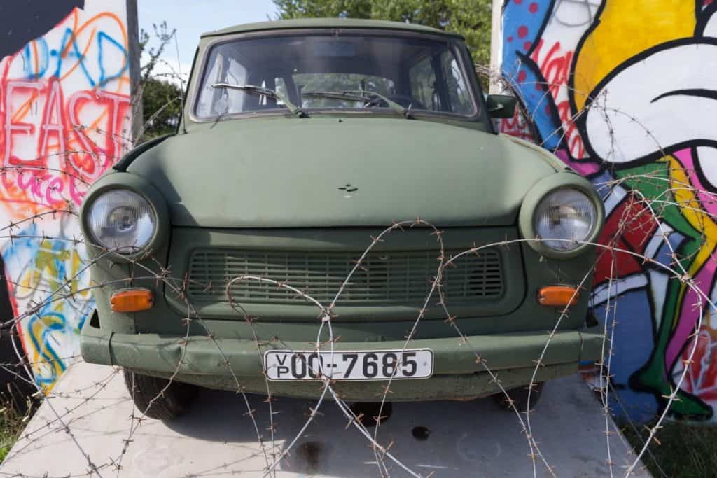 A vehicle gets ready to drive over barbed wire.
